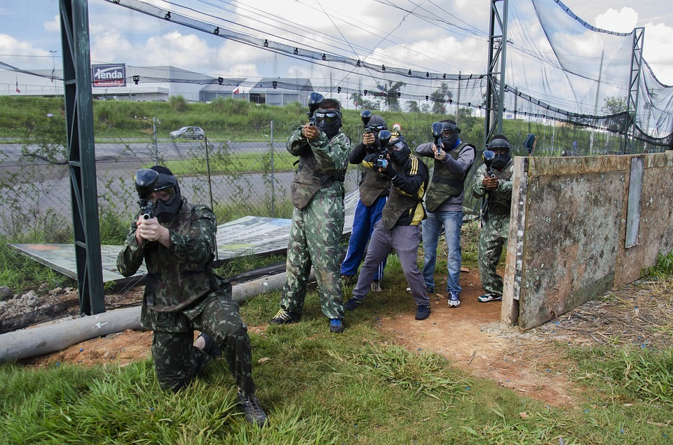 group of paintball players aiming their paintball guns