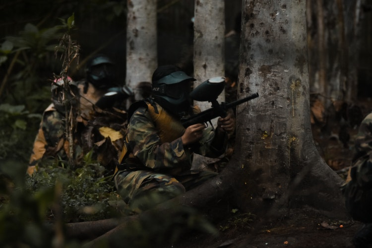 paintball players hiding in the woods